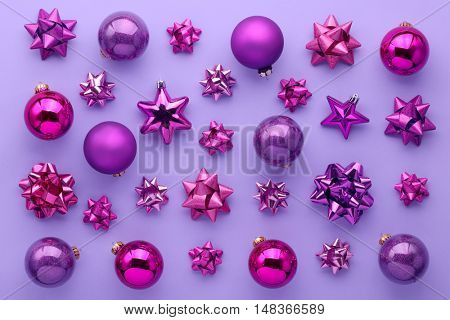 Set of christmas decorations on purple background.