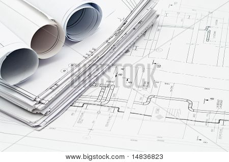 Project blueprints and measurement tools on paper