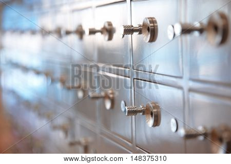 Several safes. Horizontal closeup view with shallow depth of field