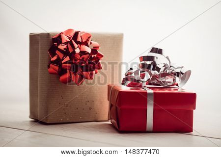 Front view of two presents on the floor