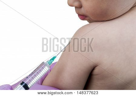 Doctor injecting a young child with a vaccination or antibiotic in a syringe, close up of the kids arm and needle. poster