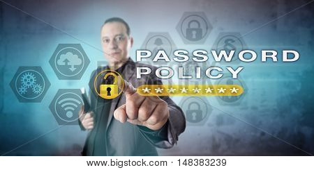 Mature business administrator highlighting PASSWORD POLICY onscreen. Computer security metaphor and information technology concept for compliance with password authentication rules and regulations. poster