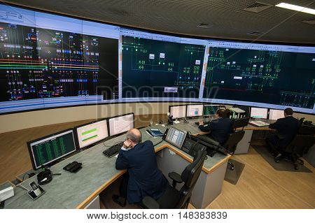 Saint-Petersburg Russia - September 22 2016: Top view of the office managing the power company. Energy engineers work at computers monitor the city grid.