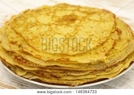 Delicious crepes with oil. Traditional crepes close-up.