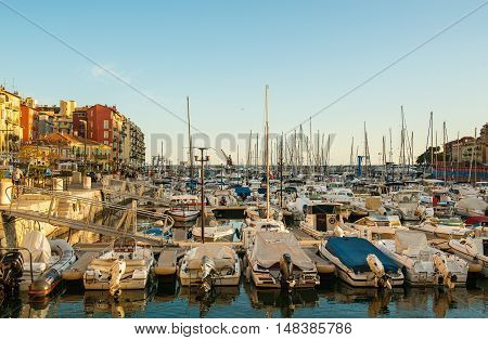 Nice, France - August 07, 2016: Port of Nice at sunset full of yachts and boats