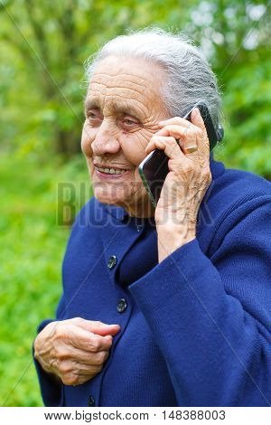 Picture of a happy senior woman talking on cell phone
