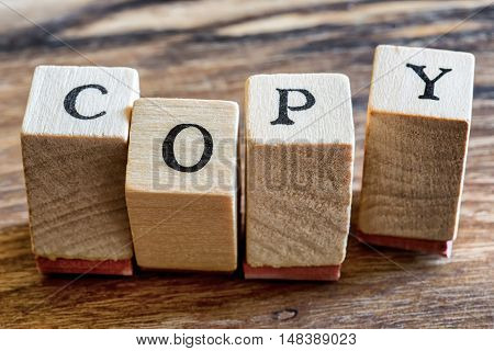 Copy Stamp on Woden Background. Copy Word Written in Wood Blocks.