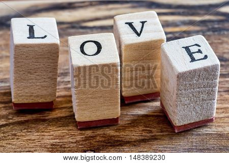 Love Happy Valentines Day Concept. Love Stamp on Vintage Woden Background. Love Word Written in Wood Blocks.