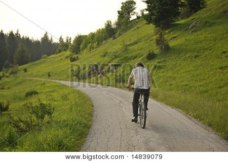 senor mature mman ride bike outdoor in nature