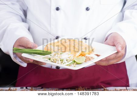 Chef presented Pad Thai plate/ cooking Pad Thai concept