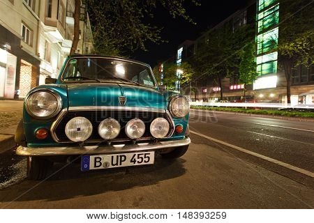 Berlin Germany May 11 2013: Tune the Mini Cooper car parked on the night street in Berlin's Charlottenburg