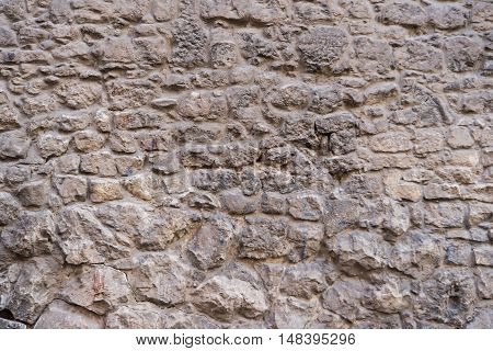 Close-up of stone stonewall, structure wall texture background