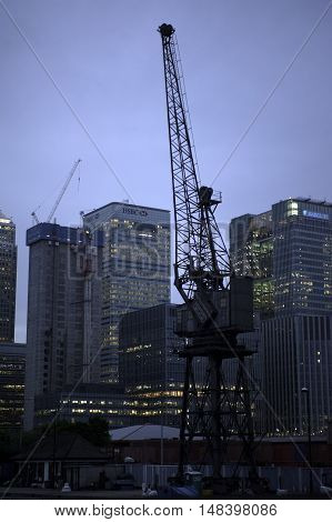 Evening view of the London Docklands area with old crane in foreground