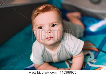 Cute Little Baby Boy Playing In Colorful Playpen, Indoors. Beautiful Child Having Fun At Nursery.