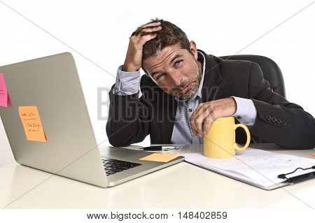 tired and frustrated businessman desperate face expression suffering stress and headache at office computer desk busy with paperwork file overwhelmed and stressed isolated on white background