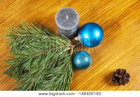 New Year 2017 decoration with blue balls and candle on wooden background