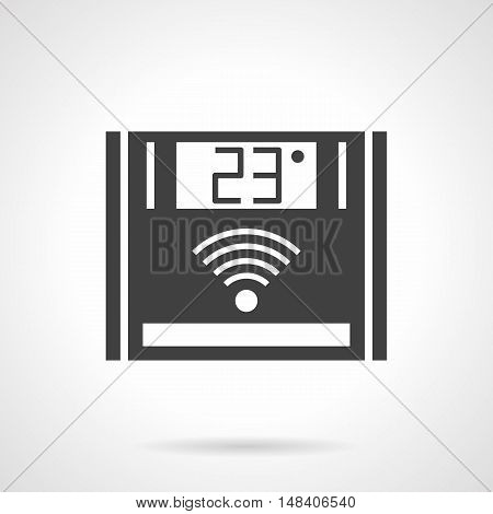 Electronic thermoregulator for floor heating. Adjusting temperature in house on digital central thermostat control. Monochrome black flat design vector icon.