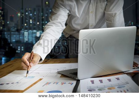 Business People Working At Night In Office.