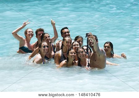 Zakynthos Greece July 15 2016:Group of friends taking a selfie in the water turquoise blue sea
