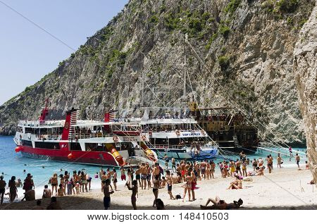 Zakynthos Greece July 15 2016: Cruise ships moored in a bay on the island of Zakynthos on the beach many tourists they are relaxing