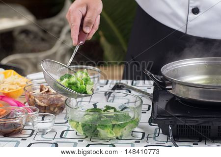 Chef scald broccoli with hot water / Stir fry Broccoli concept
