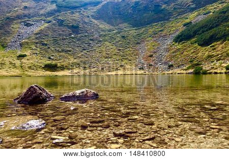 Lala Lake in Romania in Rodnei Mountains. Largest glacial lake from Rodnei Mountains.