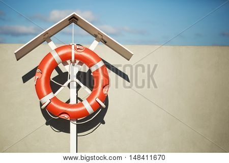 Lifebuoy on the pier on a special stand in front of a blue sky