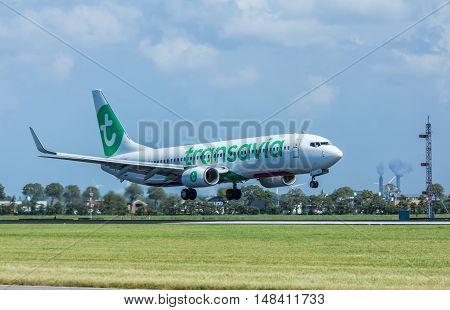 Schiphol Airport the Netherlands - August 20 2016: Transavia boeing 737 passenger aircraft landing