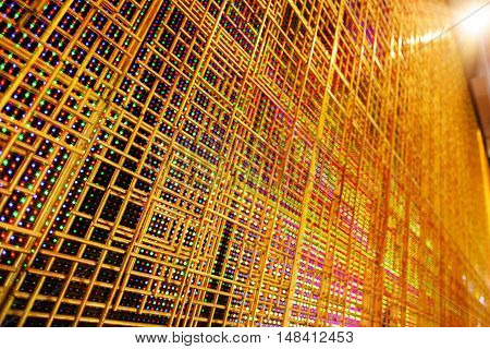 abstract LED display with golden armature in the front