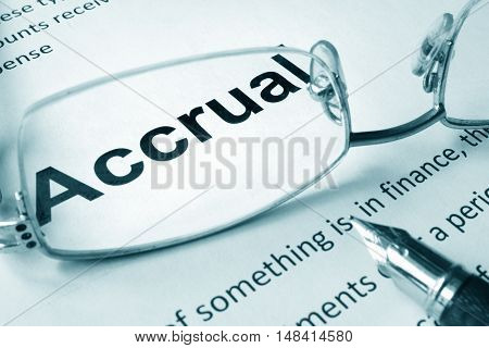Paper with sign Accrual and a pen. Business concept.