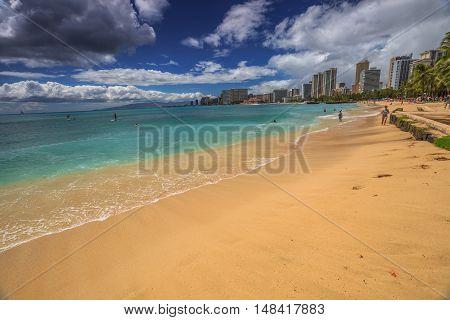 Waikiki , Oahu, HI - August 27, 2016: Waikiki Beach skyline from San Souci Beach. San Souci Beach is it off the Waikiki hotel strip and is a haven for swimmers, kayakers and surfers.