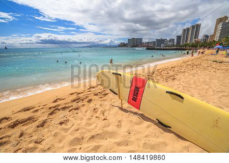Waikiki , Oahu, HI - August 27, 2016: surf rescue in San Souci Beach. San Souci Beach is it off the Waikiki hotel strip and is a haven for swimmers, kayakers and surfers. On background Waikiki Skyline.