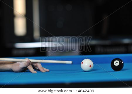 young pro billiard player finding best solution and right angle at billard or snooker pool sport  game