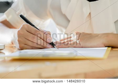 Asian Business Woman Signing A Contract Document Making A Deal..