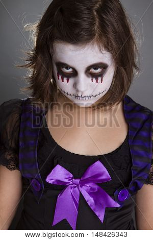the girl wearing the halloween make up