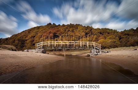 Oxwich Bay river footbridge Wooden footbridge over the river in Oxwich Bay, Gower, Swansea, UK