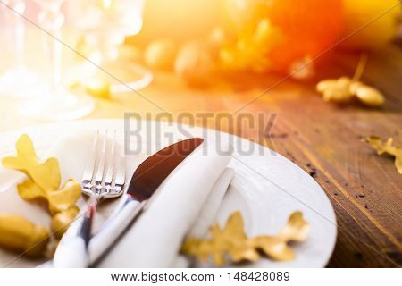 Art thanksgiving background with autumn Pumpkin on the dining table
