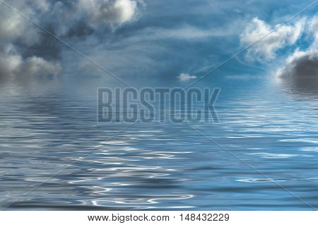 dreamy fantasy style seascape with blue sky and threatening grey clouds. the sky iis real with water added artificially.