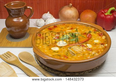 white beans with clams and vegetables on the table
