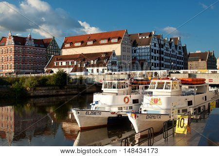 POLAND, GDANSK - AUGUST 12, 2012: Ships at berth Motlawa River in the historic center of Gdansk. Gdansk is a popular touristic city on the Baltic coast, the capital of the Pomeranian Voivodeship.