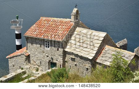 The historic Gospa od Andela Church - Our Lady of the Angels - in Kotor Bay Montenegro. The church is believed to date fom 1584 and has recently been restored.