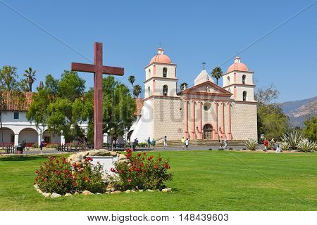 SANTA BARBARA, CALIFORNIA - SEPTEMBER 21, 2016: Cross at the Santa Barbara Mission. Founded in 1786, the present day church was destroyed by an earthquake in 1925 and later restored.
