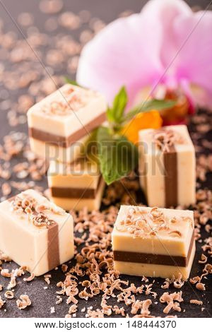 Several Two Colored Nougat Cubes On Slate