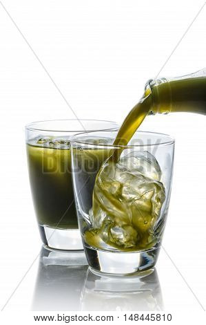 Pennywort or asiatic herbal drink in glass isolated on white background