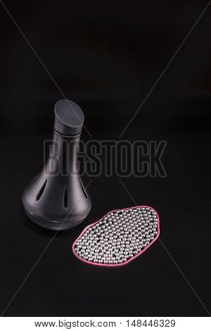 The capacity for the decanter balls on a black background.