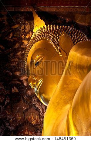 The Big golden Reclining Buddha at Wat Pho in Bangkok, Thailand. The image of reclining Buddha is 15 m high and 43 m long.