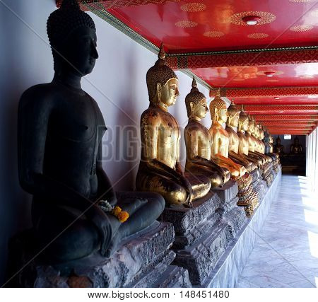 Ancient Buddha's statue at Wat Pho Temple in Bangkok, Thailand. Every Buddha's face is unique and individual.