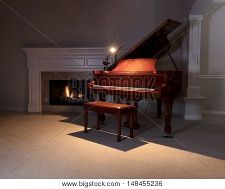 Piano with reading light on with glowing fireplace in background. Select focus on front of piano.