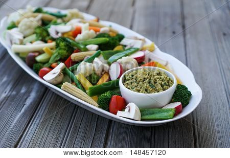 Vegetable Crudites and Dip/ vegetable platter on wood background, healthy eating, selective focus.