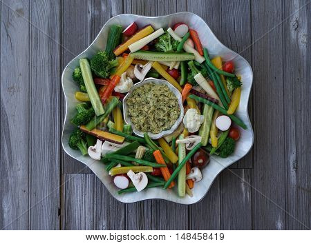 Vegetable Crudites and Dip/ vegetable platter on wood background, healthy eating, top view, selective focus
